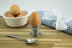 Breakfast. Eggs,eggcup,spoon,bowl and napkin tied with ribbon Stock Image