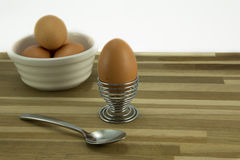 Breakfast. Egg,eggcup,spoon and bowl with eggs Royalty Free Stock Photos
