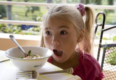 Breakfast 3. Little girl has a breakfast in open air 2 Royalty Free Stock Images