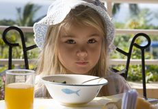 Breakfast. Little girl has a breakfast in the open air Stock Photos