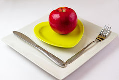 Breakfast. Red Apple On Green Plate Stock Image