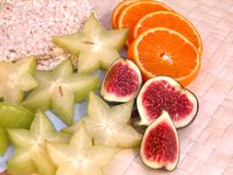 Breakfast. On diet - rice-cakes, figs, carambola and oranges Stock Photos