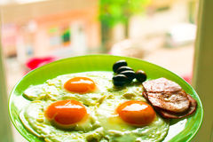 Breakfast. Food with eggs, bacon and olives Royalty Free Stock Photo