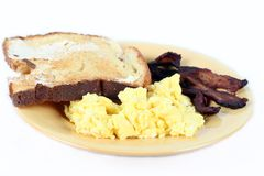 Breakfast. A breakfast of bacon, eggs and toast isolated on white Royalty Free Stock Photos