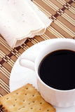 Breakfast. Coffee and cracker on matting table Stock Photo