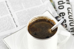 Breakfast. Black coffee and newspaper. Breakfast stock photos