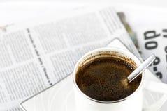 Breakfast. Black coffee and newspaper. Breakfast stock image