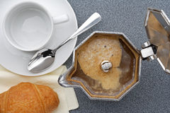 Breakfast. Moka express with coffee froth ready for a breakfast Stock Photos