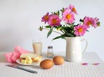 Breakfast. Sunshine breakfast table with dahlia Royalty Free Stock Photo