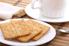 Breakfast. Cracker before a cup of cofee Stock Photography