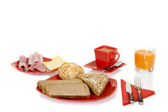 Breakfast. Arrangement with bread,orange juice and coffee isolated on white background Stock Images