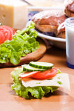 Breakfast. Fresh Vegetables and chees on bread Royalty Free Stock Photo