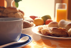 Breakfast. Morning meal;coffee,croissant ,bread,fruit and orange juice,sepia tone Royalty Free Stock Images