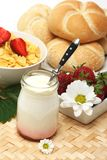 Breakfast. Organic yogurt,delicious strawberries with flowers and bread for breakfast stock photography