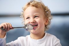 Breakfast. Portrait of the little boy eating yogurt Stock Photography