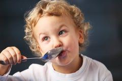 Breakfast. Portrait of the little boy eating yogurt Royalty Free Stock Photos