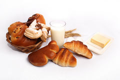 Breakfast. Products for breakfast - pastries, milk, butter and eggs Royalty Free Stock Images