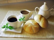Breakfast. Coffee and fancy rolls royalty free stock image