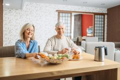 Breakfast of adult love couple at home royalty free stock photos