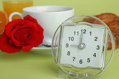 Breakfast and alarm clock Royalty Free Stock Image