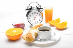 Breakfast and alarm clock Royalty Free Stock Photo