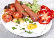 Breakfast. Appetizing breakfast with fried eggs fried eggs and fried sausages Stock Photography