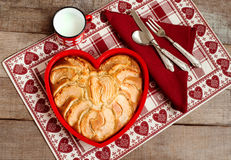 Breakfast apple pie with milk mug over heart decorated country p Royalty Free Stock Images