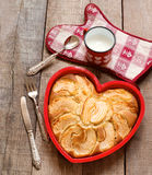 Breakfast apple pie with milk mug over heart decorated country p Stock Photos