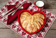 Breakfast apple pie with milk mug over heart decorated country p Stock Image