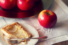 Breakfast. Apple pie and some apples royalty free stock photos