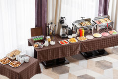 Free Breakfast At The Hotel. Buffet Table With Dishware Waiting For Guests Royalty Free Stock Image - 96498686
