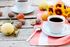 Breakfast autumn afternoon tea, nuts, apples and plums Royalty Free Stock Photo