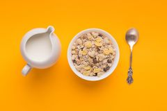 Breakfast background - milk, muesli, spoon top view royalty free stock photography