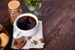 Breakfast background with mug of fresh coffee, homemade oatmeal cookies, grind coffee. Breakfast background with porcelain mug of fresh black coffee, homemade Royalty Free Stock Image