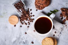 Breakfast background with mug of fresh coffee, homemade oatmeal cookies, grind coffee. Breakfast background with porcelain mug of fresh black coffee, homemade Royalty Free Stock Photo