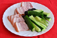 Breakfast with bacon and cucumber Stock Images