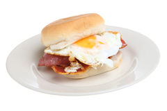 Breakfast Bacon & Egg Roll. Soft white bread roll with bacon & fried egg Royalty Free Stock Images