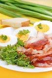 Breakfast with bacon and eggs Stock Photos