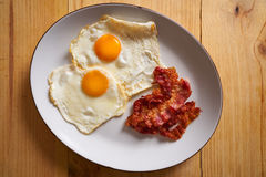 Breakfast bacon and eggs over easy Royalty Free Stock Photo