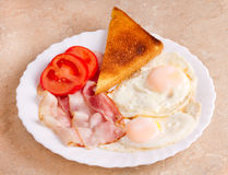 Breakfast of bacon and eggs Royalty Free Stock Images
