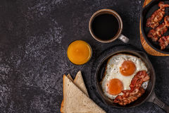 Breakfast with bacon , fried egg, coffee and orange juice. Royalty Free Stock Photo