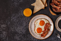 Breakfast with bacon , fried egg, coffee and orange juice. Stock Photos