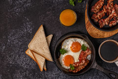 Breakfast with bacon , fried egg, coffee and orange juice. Royalty Free Stock Images