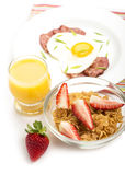 Breakfast with bacon, fried egg and orange juice Royalty Free Stock Images