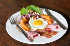 Breakfast with bacon, fried egg,sausages on grunge Stock Image