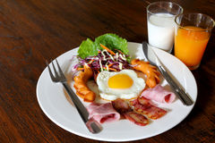 Breakfast with bacon, fried egg,sausages on grunge Royalty Free Stock Images