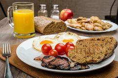 Breakfast- bacon, sausage, bread and eggs Stock Photos