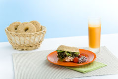 Breakfast bagel. S on the kitchen table over blue background royalty free stock images