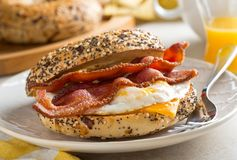 Breakfast Bagel. A delicious breakfast bagel with bacon, egg and cheese Royalty Free Stock Photos