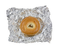 Breakfast bagel opened on tin foil Stock Photos